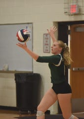 Julieanne McKee, then a member of the Spackenkill volleyball team, begins a serve in a Sept. 2018 match against Highland. McKee now plays for the Manhattan College women's volleyball team.