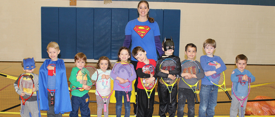 Youth Fitness Director Holly Metzger-Brown and her kids at the York JCC line up for a photo before their tennis class.