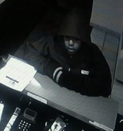 A surveillance photo of the woman wanted in connection with a recent Motel 6 robbery and assault in Manchester Township.