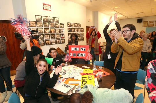 Students from Eugenio Maria de Hostos Charter School show their support during a Latina equal pay rally.