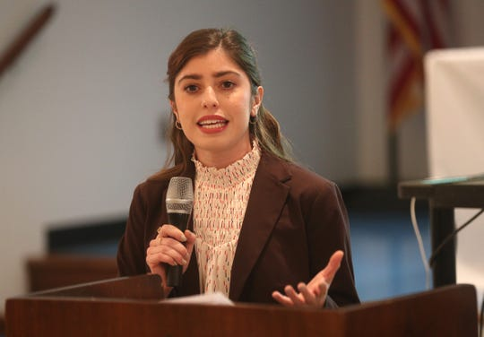 Samantha Parisi is a Latina lawyer  who took time to speak at a Latina equal pay rally.