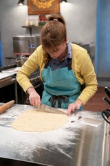 Sarah Wallace prepares pecan linzer praline sugar cookies with orange zest and cranberries on Holiday Baking Championship, Season 6.