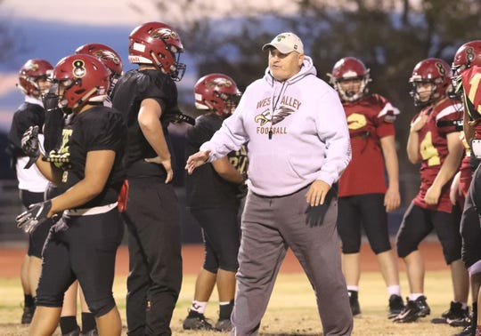 West Valley defensive coordinator Jim Vert works with Eagles players during a team practice on Tuesday, Nov. 19, 2019, in preparation for the second round of Division III playoffs at home against Paradise.