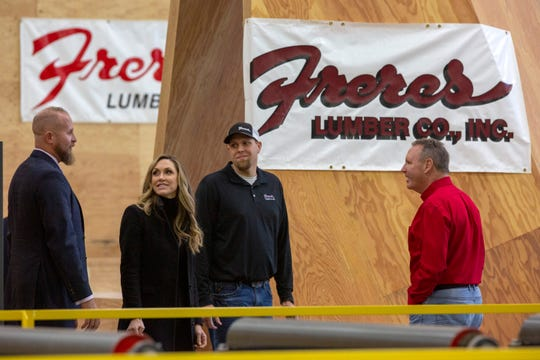Brad Parscale, Donald Trump's campaign manager, and Lara Trump, Donald J. Trump for President, Inc. senior advisor, speak with Freres Lumber employees Aaron Hutchinson, a forester, and Rob Freres, president, at Freres Lumber in Lyons, Ore. on Nov. 20.