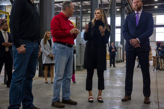 Rob Freres, president of Freres Lumber, gives a tour to Lara Trump, Donald J. Trump for President, Inc. senior advisor, and Brad Parscale, Trump's campaign manager, at Freres Lumber in Lyons, Ore. on Nov. 20. A Timber Unity listening session was held to discuss regulation in the timber industry.