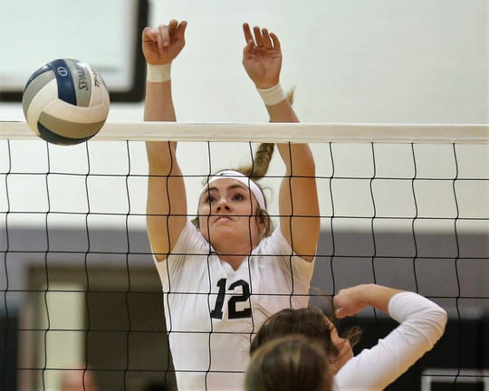 Water Valley High School's Kalysta Minton-Holland goes up for a block earlier in the 2019 season.