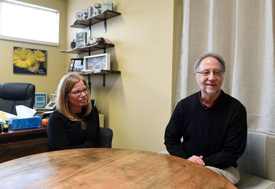 School administrator Tia Esser and school board director Scott Peters speak about the delay moving into the new school building on Wednesday, Nov. 20, at Sioux Falls Lutheran School.