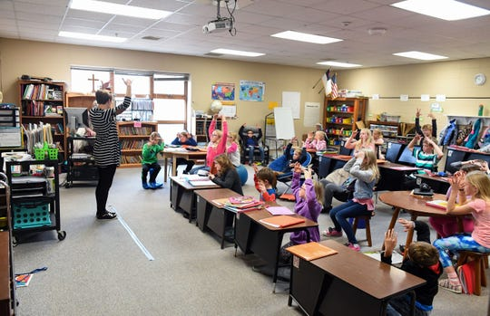 Melinda Wood teaches Spanish words for weather to a class of 26 children on Wednesday, Nov. 20, at Sioux Falls Lutheran School. This is the largest class size at the school, filling every available desk, table and seating arrangement.