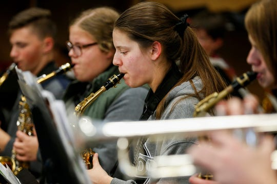 Julia Scherer plays the saxophone while rehearsing Christmas songs with the concert band at Sparta High School on Monday, Nov. 18, 2019.