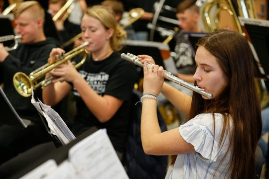 Hailey Bumgarner, right, plays the flute while rehearsing Christmas songs with the concert band at Sparta High School on Monday, Nov. 18, 2019.