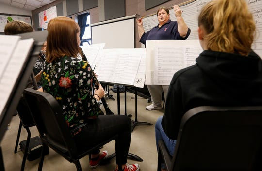 Sherry Nichols, band director for the Sparta district, directs the concert band at Sparta High School on Monday, Nov. 18, 2019.