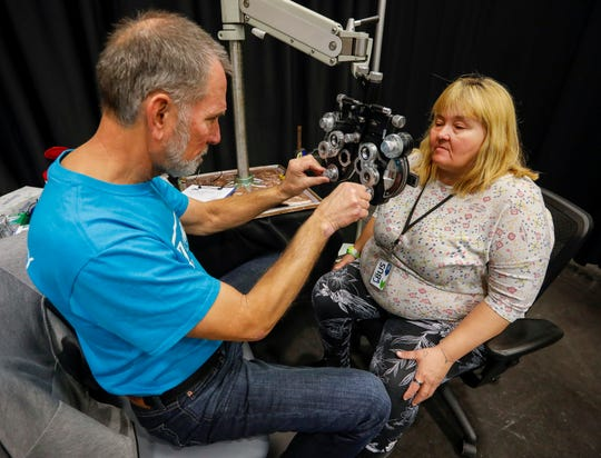 Melissa Smith gets an eye exam from Dr. Jon Treadway during the Hope Connection event at the Springfield Expo Center on Wednesday, Nov. 20, 2019. Hope Connection is a one-day, one-stop service site for the Ozarks' homeless and poverty stricken to gain access to vital services.