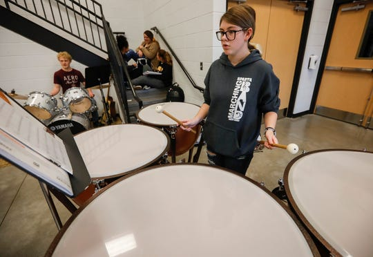 Hannah Roller plays the timpani drums while rehearsing Christmas songs with the concert band at Sparta High School on Monday, Nov. 18, 2019.