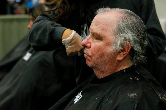 Dan McDaniels gets a haircut during the Hope Connection event at the Springfield Expo Center on Wednesday, Nov. 20, 2019. Hope Connection is a one day, one-stop service site for the Ozarks' homeless and poverty stricken to gain access to vital services.