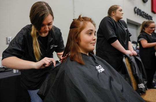 Melissa Helmig has her hair cut by Destany Cloud during the Hope Connection event at the Springfield Expo Center on Wednesday, Nov. 20, 2019. Hope Connection is a one-day, one-stop service site for the Ozarks' homeless and poverty stricken to gain access to vital services.