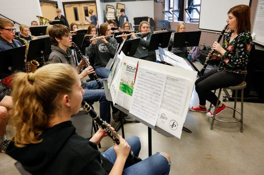 Drum Major Shayln Morris, right, leads the concert band while rehearsing Christmas songs at Sparta High School on Monday, Nov. 18, 2019.
