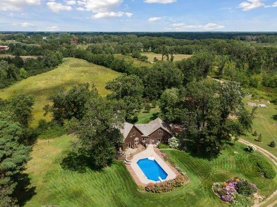 Nestled among the trees, this property encompasses 80 acres of wooded and pasture land.