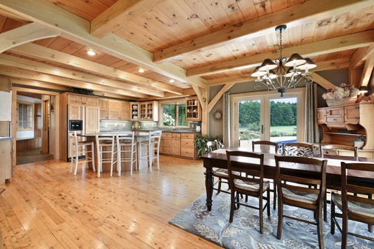 The dining room is adjacent to the kitchen which was created with an abundance of cabinetry.