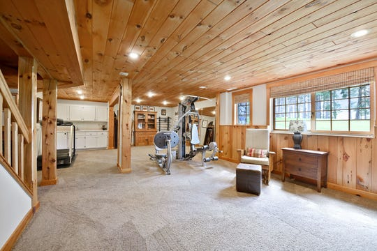 The lower level is home to a family room and is complete with a wet bar and an exercise room.