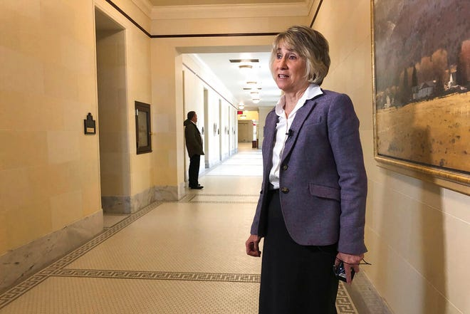 Republican Rep. Susan Pulsipher speaks outside of a hearing at the Utah State Capitol Wednesday, Nov. 20, 2019, in Salt Lake City. Amid increasing concern about vaping, Utah lawmakers are approving a proposal to allow schools to destroy confiscated e-cigarette devices. Pulsipher said that schools have seen a spike in the number of confiscated devices, but because the law is unclear they've sometimes had to return them. (AP Photo/Lindsay Whitehurst)