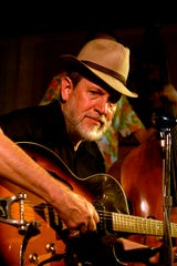 David Evans brings a lesson in blues to the Blues Tavern on Monday.