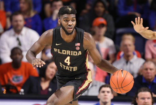 Florida State forward Patrick Williams (4) dribbles up court against Florida during the first half of an NCAA college basketball game Sunday, Nov. 10, 2019, in Gainesville, Fla. (AP Photo/Matt Stamey)