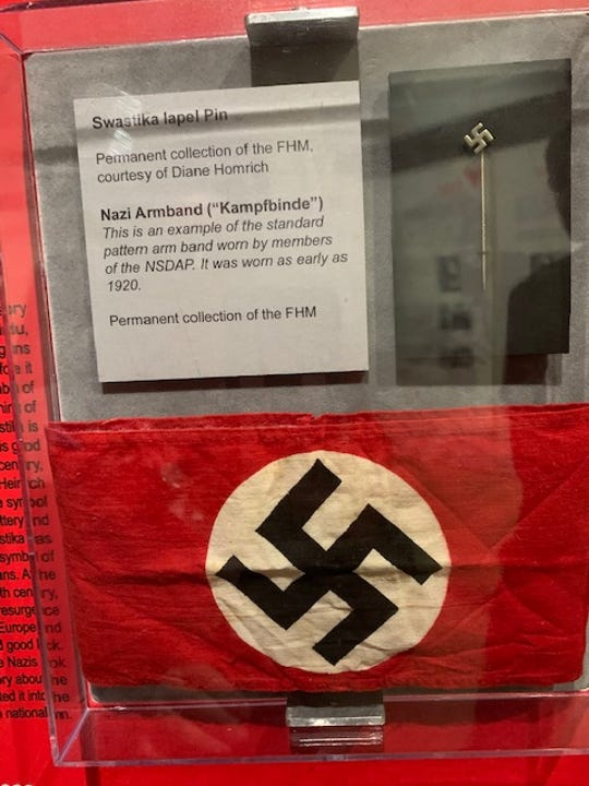 Swastika armband and pin on display at the Florida Holocaust Museum.