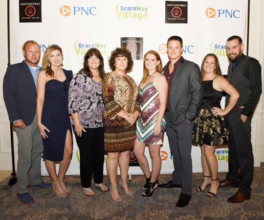 "John and Kayla Sickel, left, Elizabeth Mosher, Debbie Sides, Jessica and Scott Mosher and Brittany and Walt Posten at the 2019 ""Why Not Be Fabulous?"" Mochachino Fall Fashion Show, a benefit for GraceWay Village."