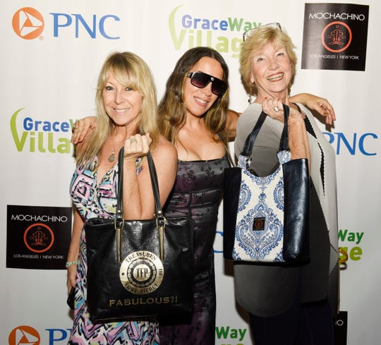 "Plythe Freedman, left, Stacey Fox and Genelle Yost at the 2019 ""Why Not Be Fabulous?"" Mochachino Fall Fashion Show, a benefit for GraceWay Village."