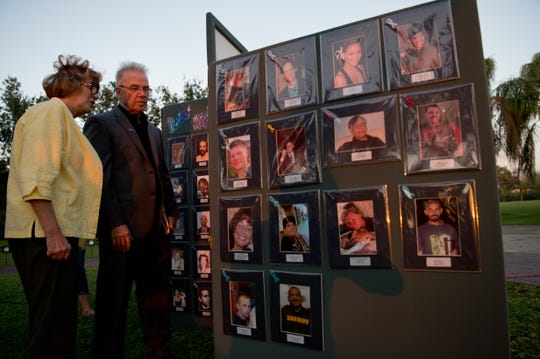 "Indian River County Victims' Rights Coalition chairman Paul Zelno and member Sharon Correa, both of Vero Beach, look at photos of victims of violent crimes after the 25th annual Memorial Vigil on Memorial Island in Vero Beach on April 6, 2017, as part of National Crime Victims' Rights Week. Zelno's wife, Donna Zelno, was killed by a drunk driver in 2007, and Correa's younger sister, Mary Ellen Wise, was murdered in 1992. ""The Indian River County Victims' Rights Coalition was not in force when my sister was murdered ... we muddled through as best we could,"" Correa said. ""Now, there's all kinds of help available immediately, which is a wonderful thing for our community."""