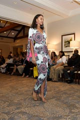 "Ivanna Forrester models a design by Sabre Mochachino at the 2019 ""Why Not Be Fabulous?"" Fall Fashion Show in Palm City."