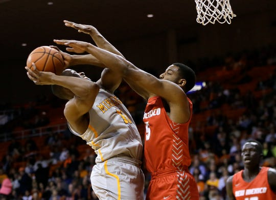 UTEP's Bryson Williams somehow gets his shot to fall covered closely by UNM's JaQuan Lyle Tuesday.
