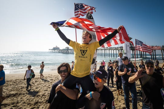 Ventura's Dmitri Poulos celebrates winning the boys Under-18 International Surfing Association World Junior Surfing Championships in Huntington Beach on Nov. 3.