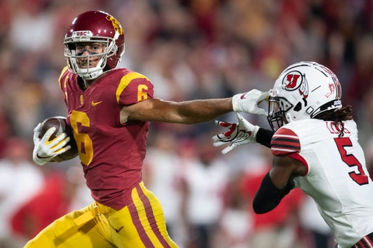 Oaks Christian School graduate Michael Pittman Jr., left, has averaged 101.6 receiving yards per game while hauling in nine touchdown catches this season for USC.