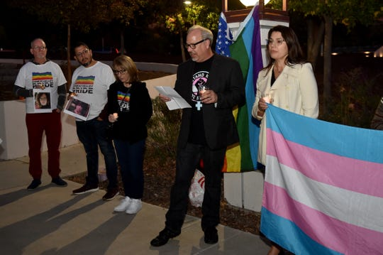 Jon Cummings, co-founder of Indivisible: Conejo, speaks to people gathered Tuesday for a candlelight vigil in honor of the Transgender Day of Remembrance.