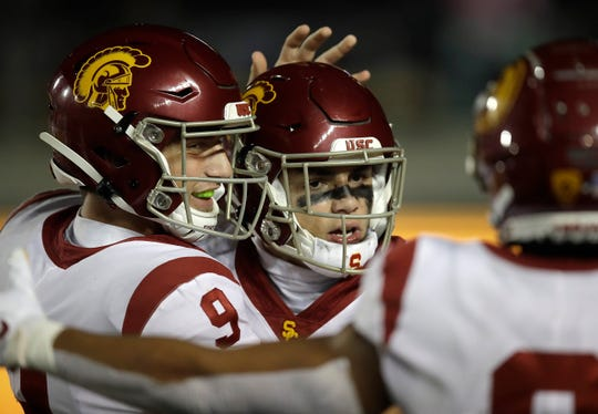 Moorpark High graduate Drake London is congratulated by quarterback Kedon Slovis (9) after scoring a touchdown during USC's win over Cal last Saturday in Berkeley.