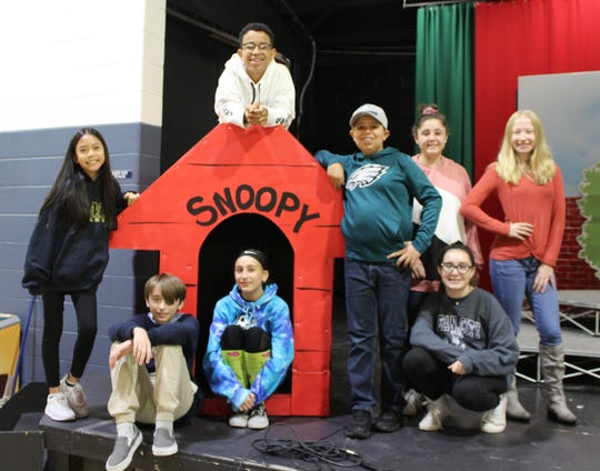 "The cast of St. Mary School's production of ""You're a Good Man Charlie Brown"" includes: (seated, from left) Keith Sawyer as Charlie Brown; Nicoletta Giuliani as Lucy; Emily Gove as Marci/Narrator; and (standing, from left) Christine Lam, chorus; Lorezo Lopes as Snoopy; Stephen Horvath as Schroeder; Sofia Pepe, chorus; and Jessica Taylor as Sally."