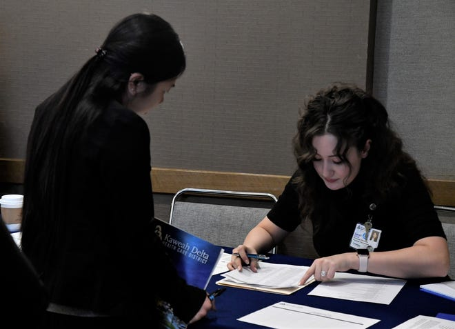 An applicant checks in at the RN Interview Day on Tuesday at the Visalia Convention Center.