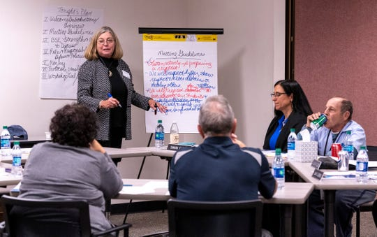 Luan Burman Rivera, standing, works with Visalia Unified School Board members Tuesday, November 19, 2019. Burman Rivera is a California School Boards Association Governance Educator/Consultant.