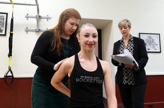 Dr. Melody Hrubes of Rothman Orthopaedic Institute, left, the Radio City Rockettes' new medical director, and Elaine Winslow-Redmond, Director of Athletic Training and Wellness for the Rockettes, give Rockette Emily King a pre-screening Nov. 18, 2019 at Radio City Music Hall in Manhattan.