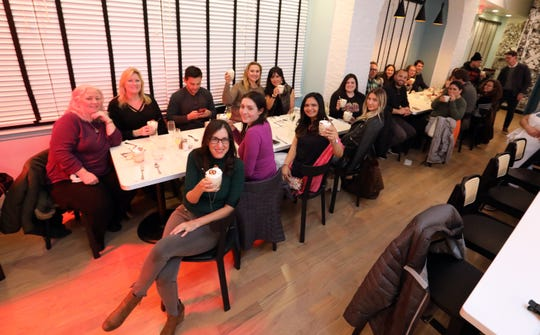 """Food & dining reporter Jeanne Muchnick, front, with the 20 guests that joined her for the """"Dinner with Jeanne"""" preview of Jay Street Cafe in Katonah on Nov. 19, 2019."""