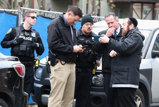 Police investigators at the scene of a stabbing on Howard Dr. In Monsey Nov. 20, 2019.