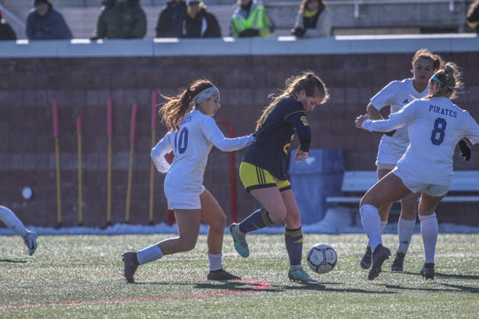 Pearl River's Samantha Roberts (10) attempts to contest Spencerport's Maddie Brongo from behind during the NYSPHSAA Class A semifinals at SUNY Cortland on Saturday, Nov. 16, 2019.