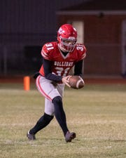 Holliday's Logan Whitling prepares to punt during a football game earlier this season.