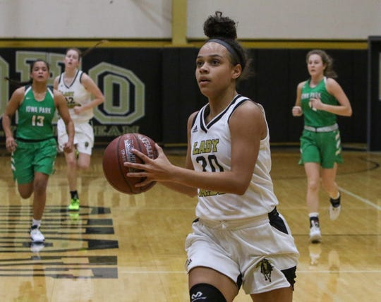 Rider's Jaelyn White drives to the basket against Iowa Park Tuesday, Nov. 19, 2019, at Rider.