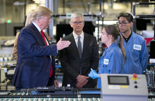President Donald Trump and Apple CEO Tim Cook tour Flextronics on Nov. 20, 2019 in Austin, Texas.