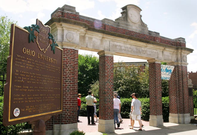 This June 12, 2006 file photo shows a gate with a historic marker on the Ohio University campus in Athens, Ohio. In October 2019, the university announced the blanket suspension of 15 fraternities in response to a hazing investigation on campus.