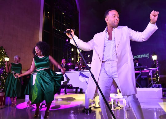 John Legend spreads holiday cheer at the historic Union Station on November 19, 2019 in Los Angeles.