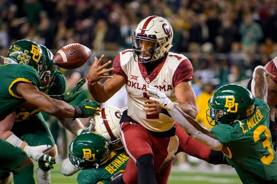 Oklahoma Sooners quarterback Jalen Hurts fumbles the ball during the game against the Baylor Bears.