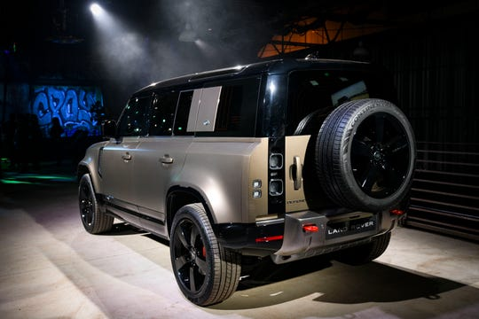 Land Rover shows off its new version of Defender at the Los Angeles Auto Show on Tuesday night.